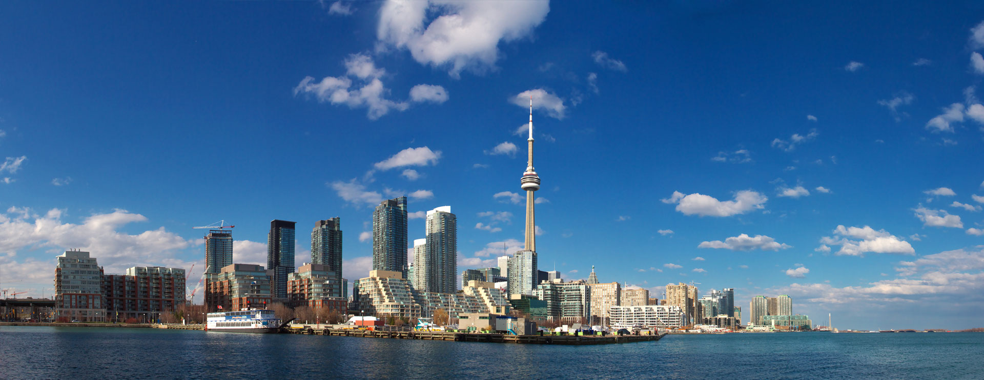 Promotional banner for the 2020 Inspiring Public Confidence conference. The banner contains a skyline image of the city of Toronto.